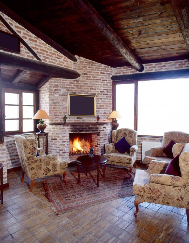 Brick does a lot more than simply convey urban sophistication and revitalization. In this living room, the brick medium shines with homespun coziness, while an undercurrent of utility (the built in fireplace) allows guests and permanent residents alike to feel secure and comfortable.