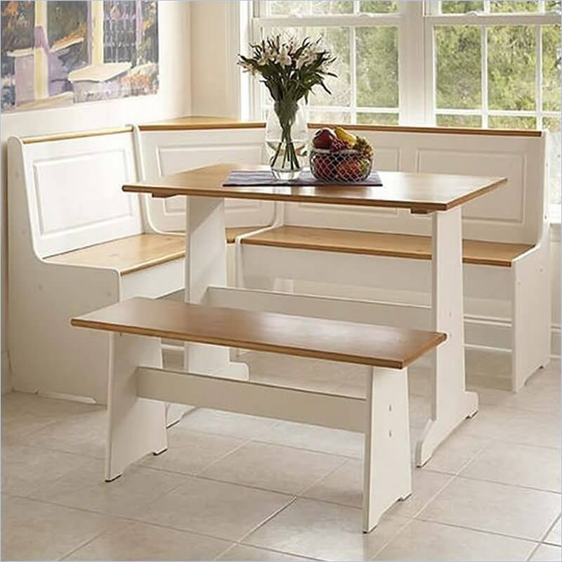 The white body on this corner dining set makes for a comfortably light contrast, working in both traditional wooden spaces and brighter, more contemporary rooms. The set features a high top table in light natural wood, with matching horizontal surfaces throughout for a soft farmhouse appeal.