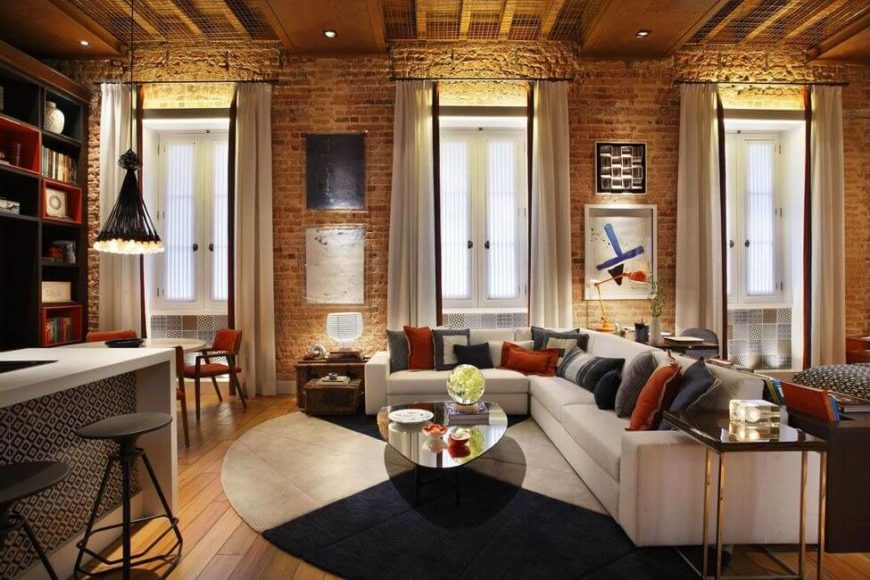 Depending the type of furniture, appliances, and furnishings surrounding it, brick can easily mix with lots of different kinds of decor. In the example above, brink can help turn an urban space from typical to completely original.