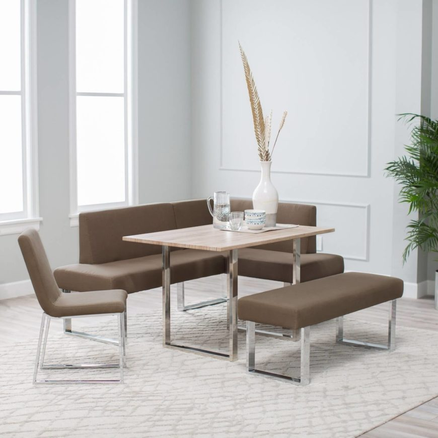 This contemporary corner dining set features a high contrast, sleekly modern look that pairs white oak, stainless steel, and light brown fabric upholstery. The trio of textures forms a cohesive dance, centered on the rich wood texture of the table. This set could add some major contrast to a neutral hued room or blend right in with a more modern layout.