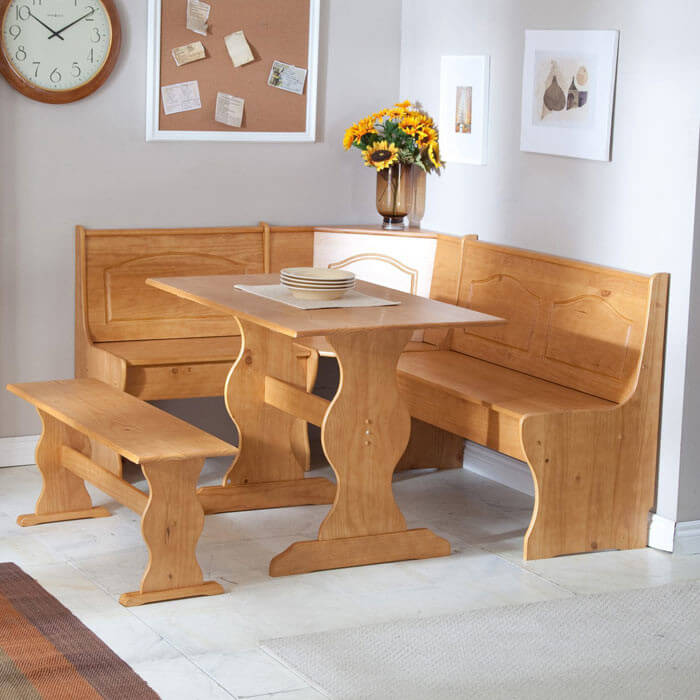 With a beautiful pine finish, this sturdy corner dining set is perfect for family meals in a relaxed setting. The set features storage hidden beneath the benches, as well as a stylishly carved back, covering both utility and aesthetics in an unassuming package. With its hardy construction, it could even work as a breakfast setup on a patio or garden.