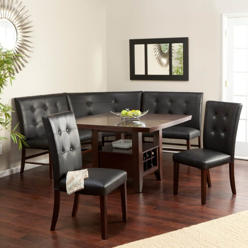 We've reached one of the more elaborate corner dining sets in our collection, featuring button tufted black leather upholstery and dark, espresso stained wood construction. The table itself features lower level shelving for extra storage as well as a built-in wine rack. The entire set is deceptively light and adaptable, fitting perfectly in a variety of home settings.