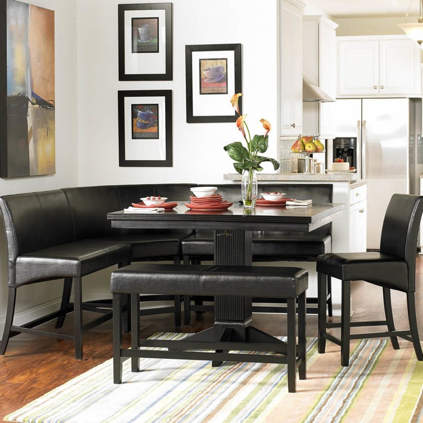 This multi-pieces set is designed with flexibility in mind, with the ability to be configured a number of different ways. The high seat backless bench and counter-height table are paired with a wraparound set of bench seating that's upholstered in ebony leather over matching black hardwood. This is one of the rare pieces that we'd call equally at home in a traditional or contemporary setting.