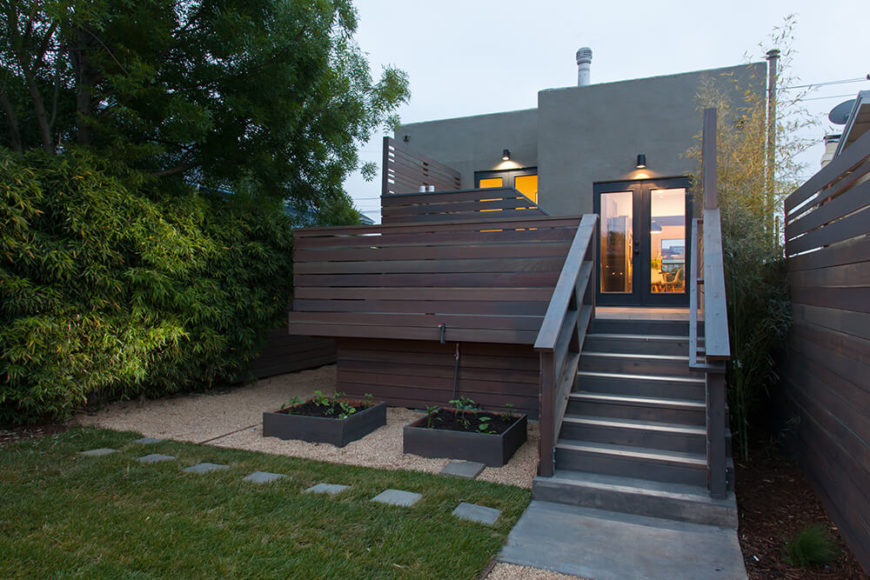 Here's a close look at the beautiful split-level deck wrapping the rear of the home, creating an intimate transition from the indoors to the open back yard.