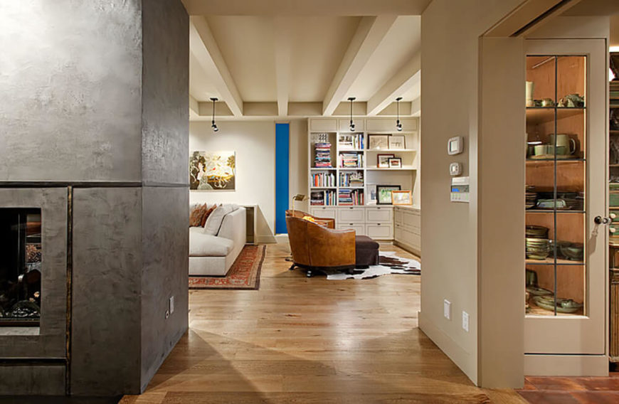 At night, with the abundance of subtle interior lighting turned on, we can see the bright shelving and storage components worked into nearly every open space, an equally aesthetic and functional component of the design.