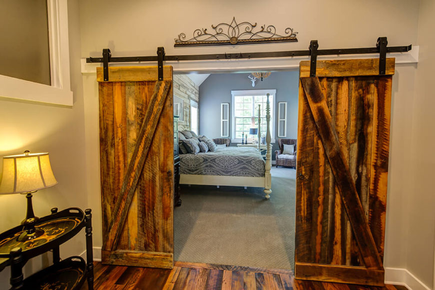 Likewise with the primary bedroom entrance, the rolling barn doors, complete with wrought iron door wheels, lend to the home a sense of strength and built-to-last materials.