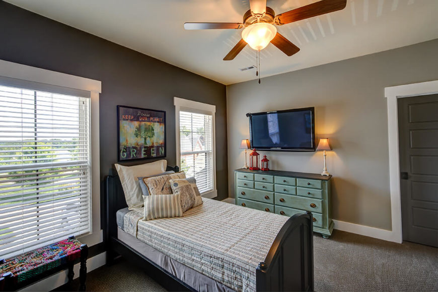 A smaller room at the front of the house boasts two large windows overlooking the front yard. The overhead ceiling fan is sure to keep the room's air flow and ambiance moving along.