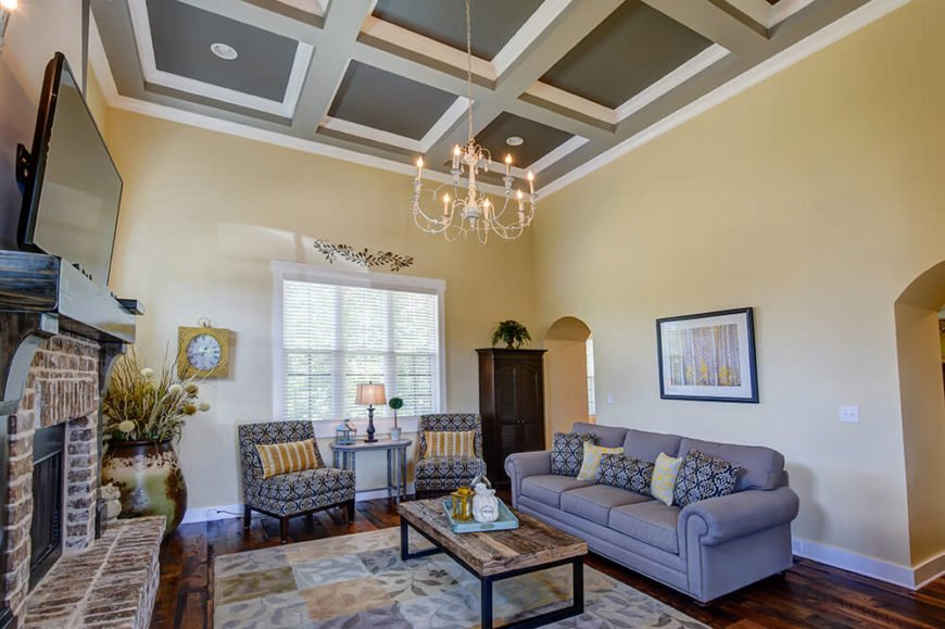 The family room, from another angle, features curved-top doorways, turning what may at first seem like a small space into a perfect transition room between the adjacent kitchen and dining room.