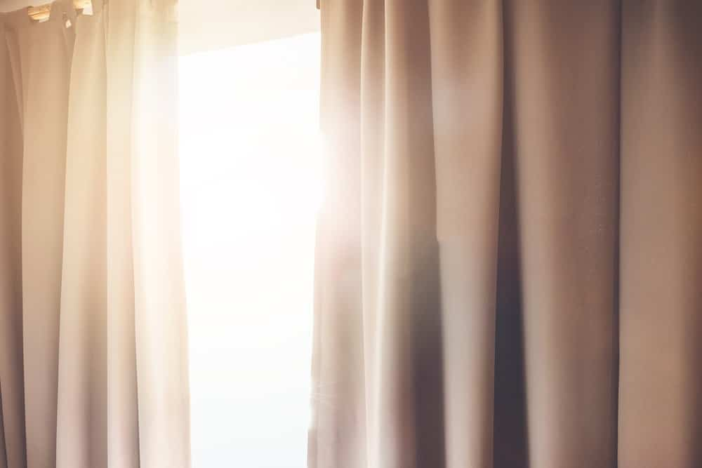 Sunlight filtered by the window and curtains.