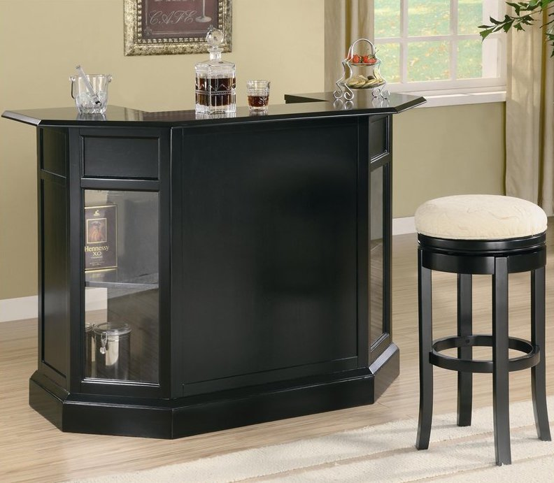 If you've got a more contemporary styled man cave, you might want to check this bar out. The sleek black construction boasts a glossy bar top and half-octagon design that helps it really stand out in any space. The glass shelf windows add an extra layer of luxury and make for a unique storage solution.