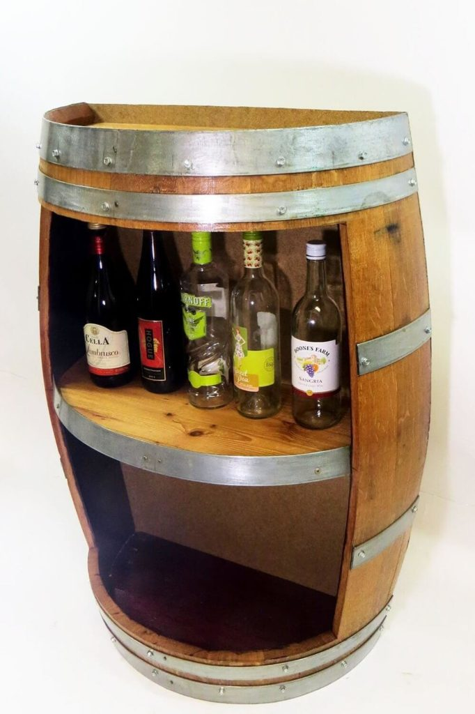 This gorgeous piece of rustic industrial fun is handcrafted with reclaimed wine barrel wood for an authentic look. This would fit in perfectly with any bar-oriented man cave, a rustic setting, or even something more rugged like an industrial or garage styled space. There's plenty of room for your bottles, and it can be tucked safely out of the way against any wall.