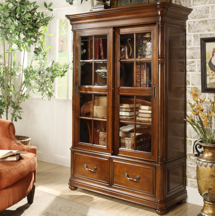 Speaking of bookcases, certain man caves might find this model much more fitting. It's a tall, attention grabbing unit wrapped in ornately carved wood, with glass cabinetry and tough metal hardware. This is one of those standout pieces of furniture meant to dominate the visuals of a room, so if your style runs more luxurious than minimalist, it could be the perfect fit.