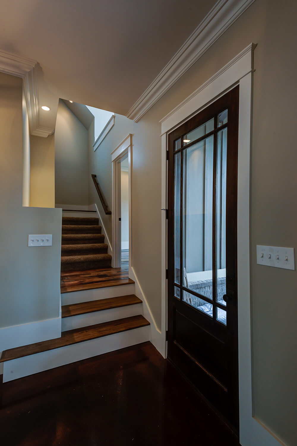 The stairs lead up to the second floor with a landing that opens in the study. The second floor consists of a bonus room that runs along the side of the house over the garage and bedrooms.