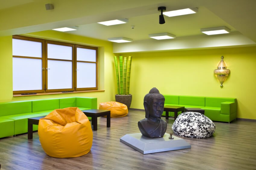 Here's an example of a colorful yoga studio design. I think it works, but then I like bright colors.