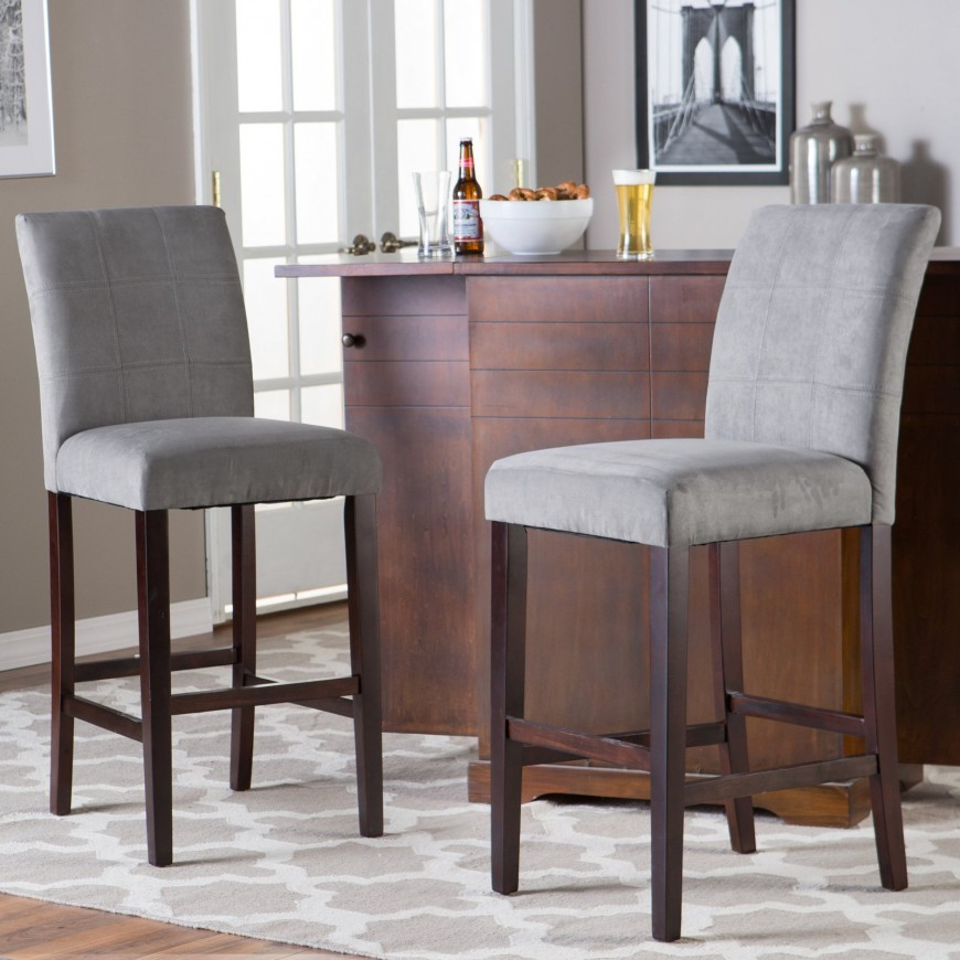We come full circle back to a sleek and simple contemporary design for our last man cave bar stool. This elegant design features soft grey upholstery over a rich, dark wood frame for a lightly contrasting look that would be at home in rooms of a variety of styles. It's close enough to neutral to fit in with a traditional man cave, but svelte enough to work wonders in a more modern setting. The high back is a great addition for ultimate comfort.