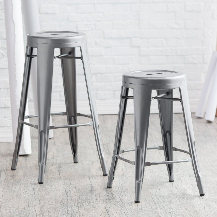 One of the most popular designs for man caves is the most rugged, tough, and dare we say, manly of styles: industrial. It's popular both because it's eye catching and because it's often so very utilitarian. These industrial styled gun metal bar stools are tough, simple, and comfortable, covering all important bases for man cave furniture.