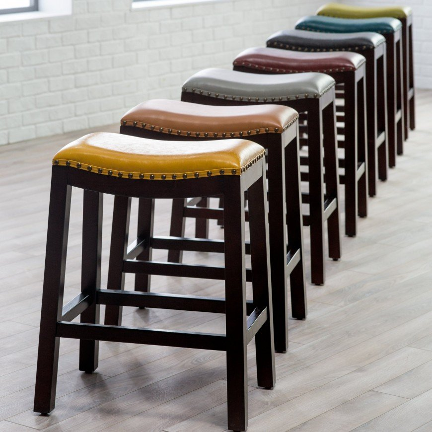 Similar to our previous entry, the saddle styled bar stools here come in a startling variety of colors, framed in nailhead trim for a uniquely eye-catching look. The color options are a big deal, as most bar stools appear in neutral shades. This means that you can add a bit of highlight to a more neutral toned man cave, or match your prevailing colors perfectly with just the right leather upholstered stool.