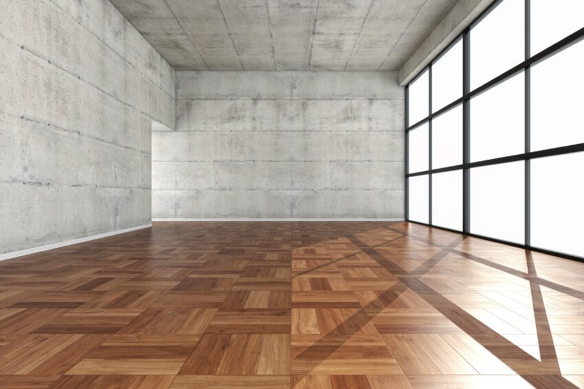 Yoga space design with concrete walls wood floor