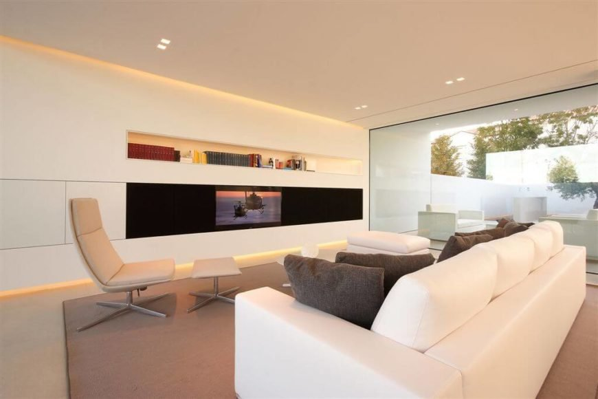 One long built in self sits above the television. This is good sleek and interesting choice for this minimalist and modern space.