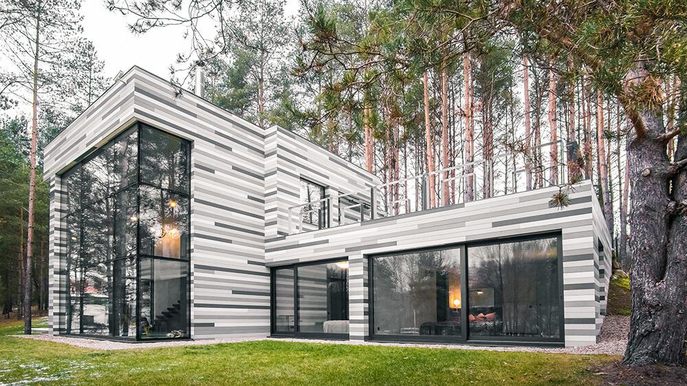 Incredible modern home with an exterior facade resembling birch bark.