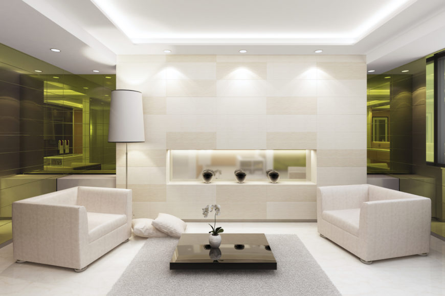 This living room consists of mostly white, with a splash of black for some contrast. The green tinted mirrors bring some interesting color to an otherwise simple design.