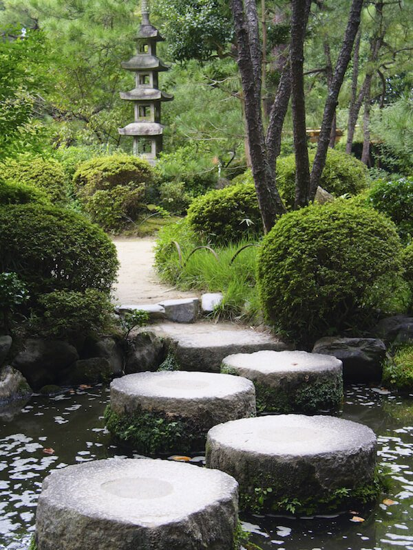 Large, flat stones are placed into the water to form a path across to the next section of this lovely Japanese garden.