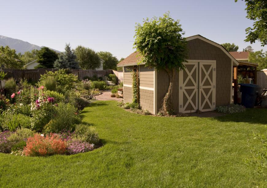Awesome backyard shed with surrounding garden.