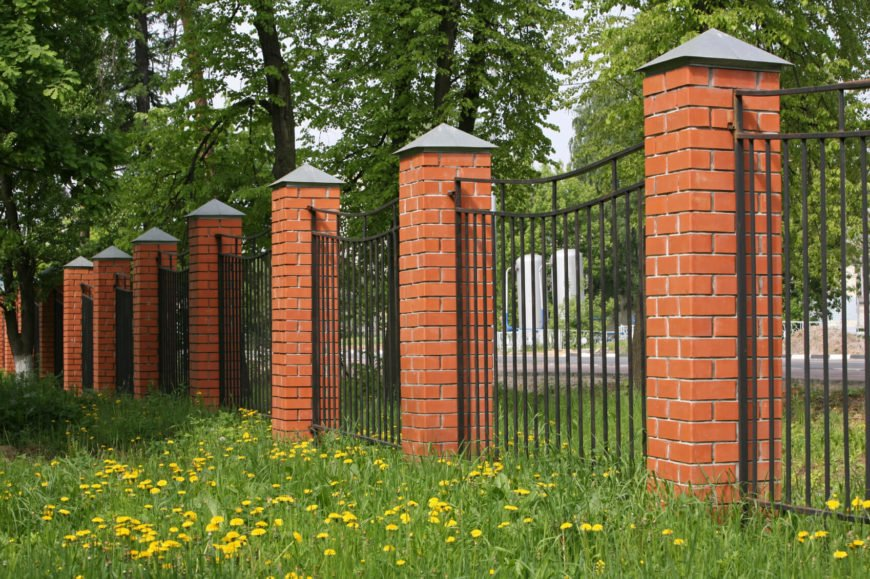 Another mixed material fence with brick. The brick posts here give a lot of strength to this bar fence.