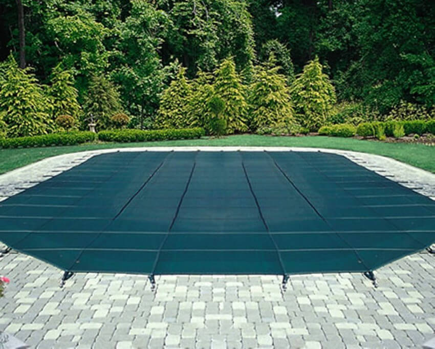Here's a great example of a simple application of a security cover on this hexagonal pool.