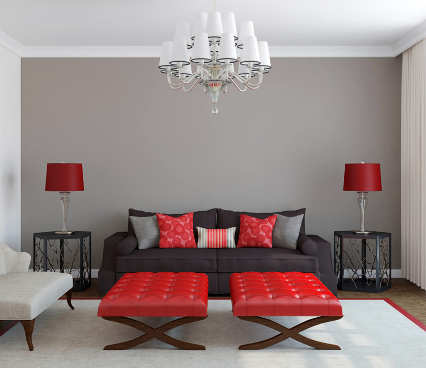 This modern and simplistic room accents a monochrome design with a vibrant red. The red makes a modern design have a great deal of pop and visual appeal.