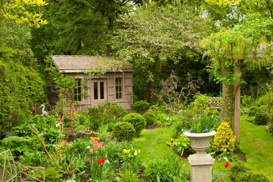 Tucked in the back corner of the yard and framed in greenery, this unassuming shed is both attractive and charming.