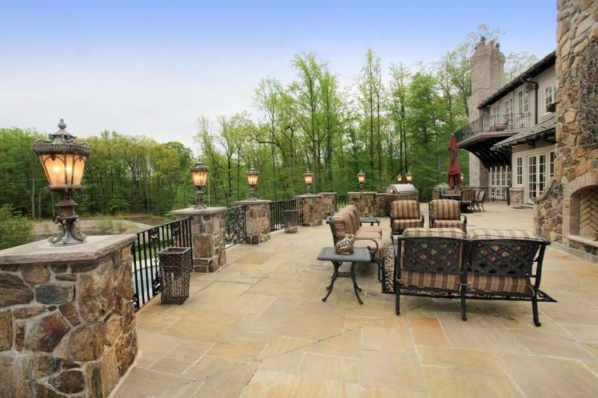 This fence uses mixed materials and a lighting element to really brighten up this patio area.