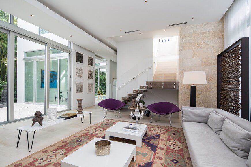 These very modern chairs accent the room very well. Being of a wildly different colors than most of the other room draw attention and increase the visual appeal.