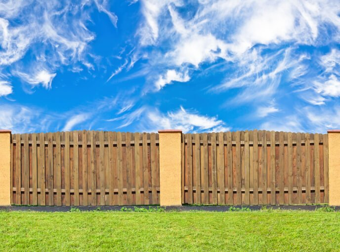 Wooden fences can also be enhanced with mixed construction.