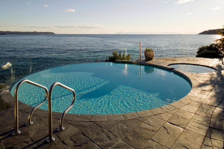 This is a great round pool, with an infinity edge. With a much smaller pool of to the side.