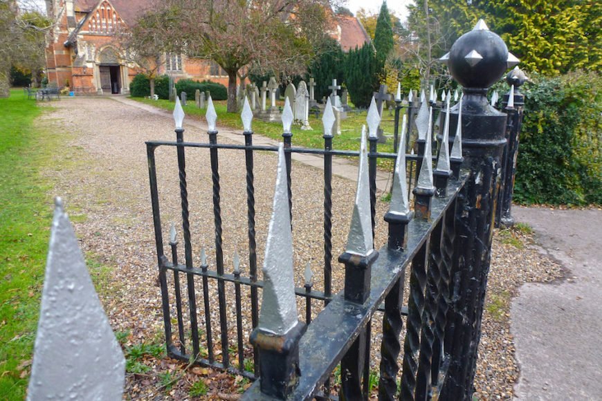 Adding a design element to a fence post is a good way to bookmark a fence. This medieval looking design punctuates the fence well.