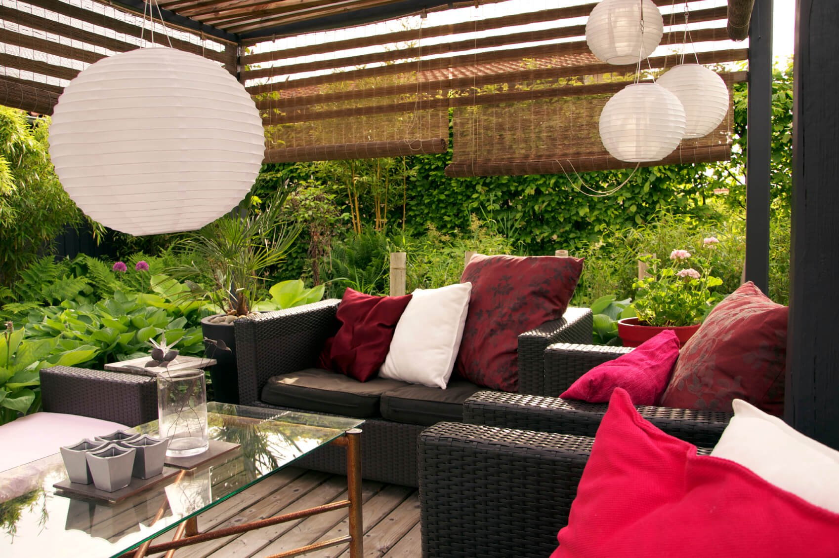 Hanging shades are a way to break up space and build privacy. You can hang them from the end of an overhang, but you can also build or buy a simple wooden frame to hang them from and have a mobile screen that you can place wherever you please.