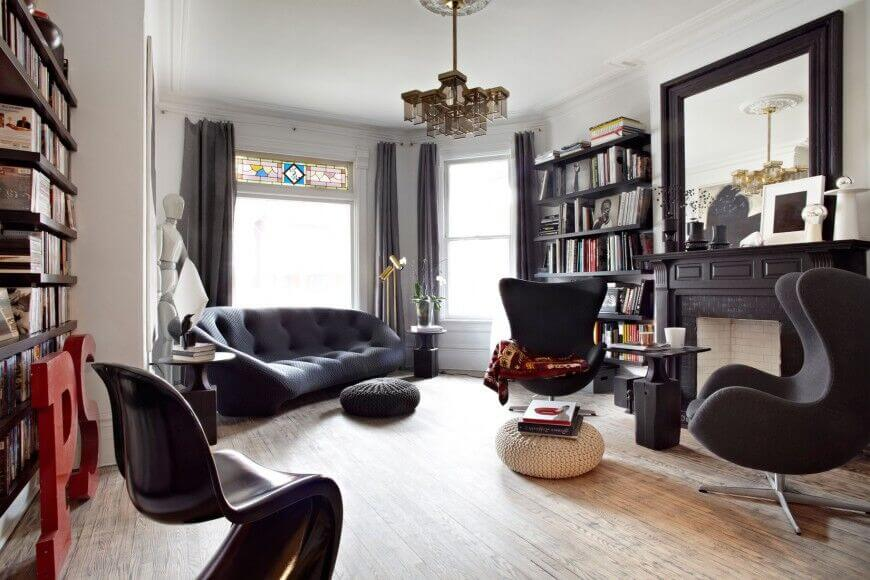 These black floating shelves match the furniture and hearth, tying the room together and proving much space for a variety books. The messy book look gives a lived in, and well read look.