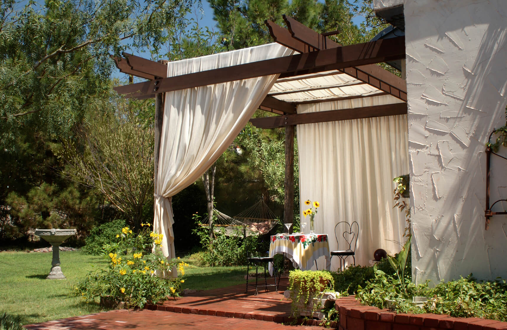 Using curtains is another version of privacy screens that provides a fun and breezy way of accomplishing the job of a privacy screen. While white outdoor curtains have a traditional look, curtains can be made from a countless variety of materials, patterns, and colors.