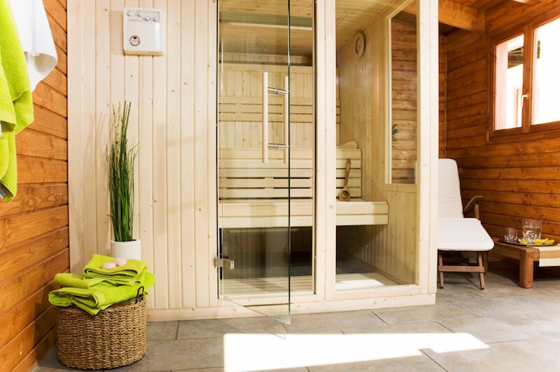 The sauna building opens up into a small bathroom area, with the actual sauna booth in the corner.