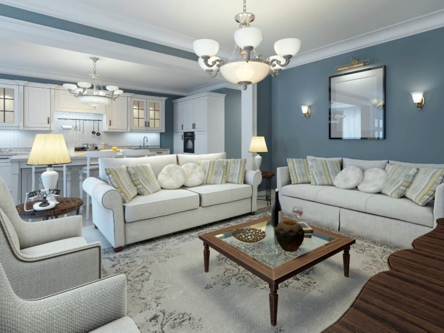 This room has a light and cool color palette, with a few pieces of furniture bringing dark rich wooden tones to contrast. There are hits of green in some of the patterns, but mostly the palette for this room is blue, blue-silver and white.