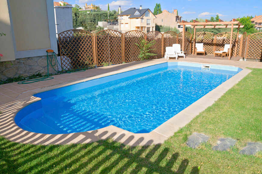 This stylish lattice fence provides this pool area with an interesting visual component.