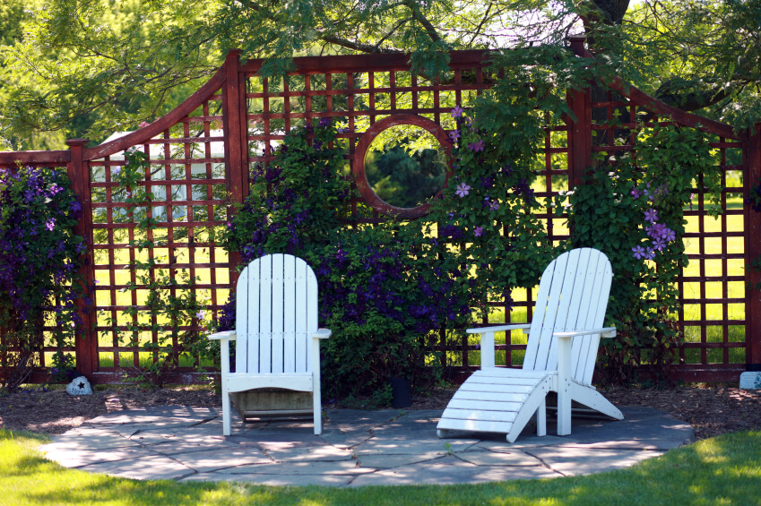 Whether on their own, covered in vines, large or small, wooden or vinyl, privacy screens provide shade, dampen noise, and spice up almost any yard.