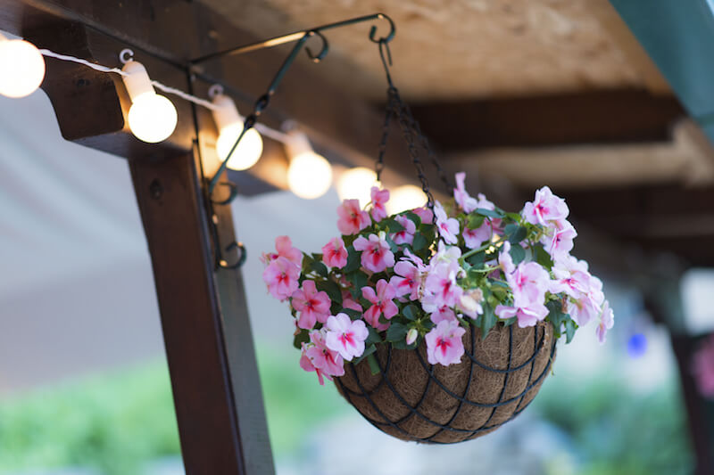 Adding a strand of hanging lights to the top of a patio or pergola is a great way to ensure that your relaxation area remains well lit into the night.