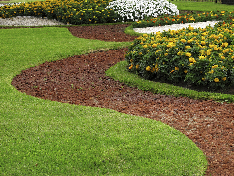 To limit how much grass your lawn has, add large pathways or planting beds. Just be aware that you'll have to mow or weed whack around them.