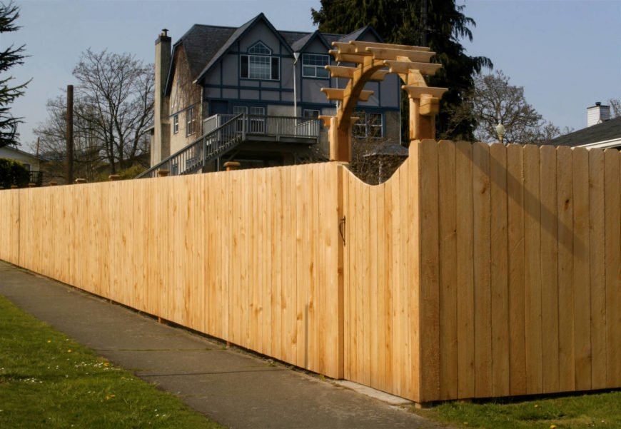 Simple privacy fences can be enhanced with interesting gateways.