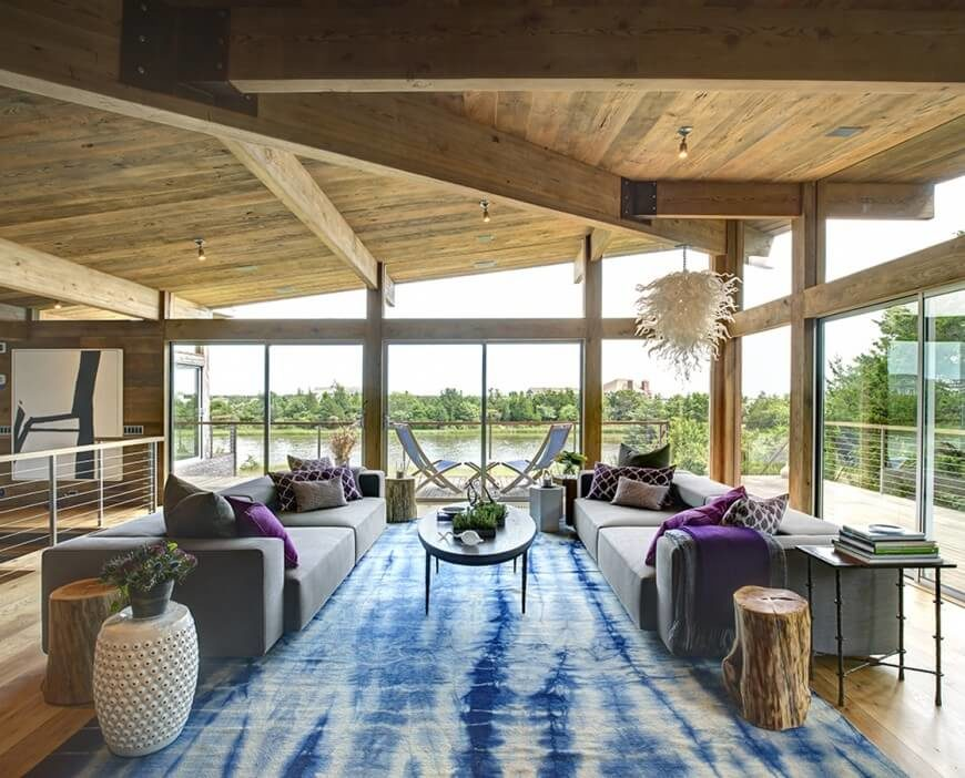 This room sides on the cooler shades. The grays work well with the cool blues and purples. The natural wood colors of the ceiling and the floor show that the wood tones can go with most any color themes.