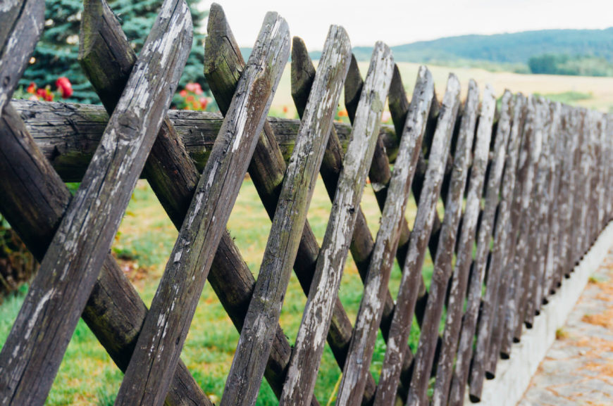 A stick wood lattice fence is a good old style design.