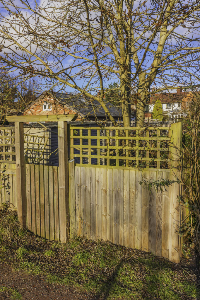 Fences made from multiple kinds of woods can have a dynamic appeal.