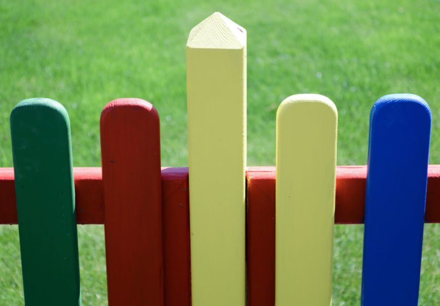 Another fence playing with color. On this fence, the posts are rounded giving a fun and playful design.